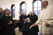 Pope Francis greets Sister Marie Mathilde, 102, during his unannounced visit to the Little Sisters of the Poor residence in Washington Sept. 23. (CNS photo/L'Osservatore Romano, handout)