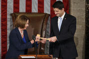 Former U.S. House Speaker and current Minority Leader Nancy Pelosi, D-Calif., hands incoming House Speaker Paul Ryan, R-Wis., the gavel after his election on Capitol Hill in Washington Oct. 29, 2015. (CNS photo/Gary Cameron, Reuters)