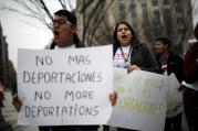 Demonstrators call for an end to deportations in a protest outside the White House in Washington in late December. (CNS photo/Carlos Barria, Reuters)