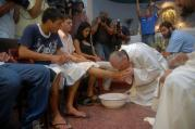 Argentine Cardinal Jorge Mario Bergoglio washes and kisses the feet of residents of a shelter for drug users during Holy Thursday Mass in 2008 at a church in a poor neighborhood of Buenos Aires, Argentina. The challenges and experiences of the church in Latin America figure heavily in Pope Francis' papacy, especially when it comes to making bishop appointments, addressing global issues and the pastoral care of the poor and the marginalized. (CNS photo/Enrique Garcia Medina, Reuters) See VATICAN-LETTER-LATIN