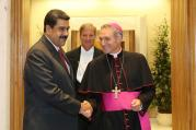 Venezuelan President Nicolas Maduro is greeted by Archbishop Georg Ganswein, prefect of the papal household, prior to an Oct. 24 private meeting between Maduro and Pope Francis at the Vatican. (CNS photo/Miraflores Palace handout via EPA)