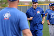 Father Burke Masters, Chicago Cubs' chaplain, takes part in a practice with players during spring training in March 2016 at Sloan Park in Mesa, Ariz. Cubs Manager Joe Maddon invited Father Masters to practice with the team. (CNS photo/Ed Mailliard, courtesy Topps)