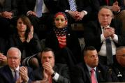 A Muslim woman adorned in an American flag listens as President Donald Trump delivers his first address to a joint session of Congress on Feb. 28 in Washington. (CNS photo/Jonathan Ernst, Reuters)