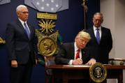 U.S. President Donald Trump signs a revised executive order for a U.S. travel ban March 6 at the Pentagon in Arlington, Va. The executive order temporarily bans refugees from certain majority-Muslim countries, and now excludes Iraq. (CNS photo/Carlos Barria, Reuters)