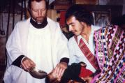Father Stanley Rother, a priest of the Oklahoma City Archdiocese who was brutally murdered in 1981 in the Guatemalan village where he ministered to the poor, is shown baptizing a child in this undated photo. (CNS)