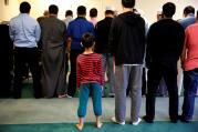A boy attends afternoon prayer in 2016 at a mosque in Sterling, Va. An update to a 2016 study on Catholic perceptions of Islam shows that three in 10 Catholics admit to having unfavorable views about Muslims. (CNS photo/Carlos Barria, Reuters)