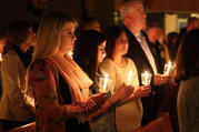 Worshippers hold candles at the beginning of the Easter Vigil at St. Louis de Montfort Church in Sound Beach, N.Y., in April 2017. (CNS photo/Gregory A. Shemitz)