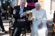 Retired Pope Benedict XVI enjoys a beer during his his 90th birthday celebration April 17 at the Vatican. (CNS photo/L'Osservatore Romano)