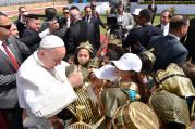 Pope Francis greets children dressed as pharaohs and in traditional dress as he arrives to celebrate Mass at the Air Defense Stadium in Cairo April 29. (CNS photo/L'Osservatore Romano)