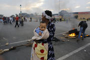 A mother and child join a housing and land protest in Johannesburg in May 2017. (CNS photo/Kim Ludbrook, EPA)