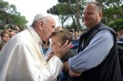 Pope Francis kisses a child during a visit to give an Easter blessing to homes in a public housing complex in Ostia, a Rome suburb on the Mediterranean Sea, on May 19. (CNS photo/L'Osservatore Romano)