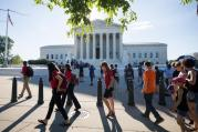 People gather outside the U.S. Supreme Court on June 26 in Washington. (CNS photo/Jim Lo Scalzo, EPA)