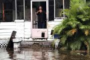 A man signals to police officers from a flooded house after Hurricane Irma passed through Daytona Beach, Fla. (CNS photo/Daytona Beach Police Department handout via Reuters)