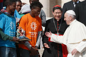 "Pope Francis greets Cardinal Luis Antonio Tagle of Manila, Philippines, and representatives of the ""Share the Journey"" campaign by Caritas Internationalis in support of immigrants, at the Vatican on Sept. 27. (CNS photo/Paul Haring)"