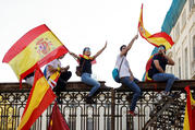 People wave Spanish flags during an Oct. 8 demonstration organized by the Catalan Civil Society organization in Barcelona, Spain. (CNS photo/Eric Gaillard, Reuters)