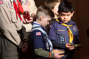 Cub Scouts participate in the presentation of the gifts during a Mass marking Scout Sunday at St. Joseph Church in Kings Park, N.Y., Feb. 5. The Boy Scouts of America's board of directors unanimously agreed Oct. 11 to allow girls into the Cub Scout program next year and let older girls become Eagle Scouts. (CNS photo/Gregory A. Shemitz)