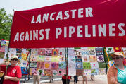 Activists with the Lancaster Against Pipelines carry a banner in late April during the People's Climate March in Washington. Nearly two dozen people were arrested Oct. 16 as they blocked workers from starting construction of a short leg of a natural gas pipeline on property owned by the Adorers of the Blood of Christ in Columbia, Pa. (CNS photo/Mark Dixon, Wikimedia Commons)