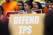 "A woman holds a sign showing her support for Temporary Protected Status, or TPS, during a rally near the U.S. Capitol in Washington on Sept. 26. Bishop Joe S. Vasquez of Austin, Texas, chairman of the U.S. bishops' migration committee, told the U.S. government on Oct. 17 that current TPS recipients from El Salvador and Honduras ""cannot return to safely to their home country at this time"" and urged their TPS status be extended. (CNS photo/Tyler Orsburn)"