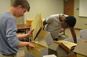 Gonzaga College High School students look through the archives in late June at Georgetown University in Washington. Gonzaga history teacher Ed Donnellan and six students searched through the archives to unearth any ties to slavery at the Jesuit-run high school. (CNS photo/courtesy Gonzaga College High School)