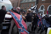 People struggle with a Confederate flag as a crowd of white nationalists are met by a group of counter-protesters in early August in Charlottesville, Va. (CNS photo/Justin Ide, Reuters)