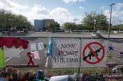 Messages hang on a fence as hundreds of students and parents arrive for campus orientation on Feb. 25 at Marjory Stoneman Douglas High School in Parkland, Fla. Attendance at the orientation was voluntary, but it was being held in anticipation of the school officially reopening on Feb. 28. (CNS photo/Angel Valentin, Reuters)