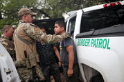 Members of the U.S. Border Patrol apprehend an immigrant from Guatemala on June 19 near Falfurrias, Texas. (CNS photo/Adrees Latif, Reuters)