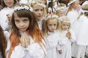 Girls gather for celebrations marking the feast of the Assumption in August 2012 in Aglona, Latvia. Twenty-five years after St. John Paul II visited Lithuania, Latvia and Estonia, Pope Francis will make the same three-nation visit Sept. 22-25, stopping at a number of the same places as his saint-predecessor. (CNS photo/Ints Kalinins, Reuters)