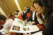 Looking at Women Church World, a monthly women's magazine insert in the Vatican's L'Osservatore Romano newspaper. (CNS photo/L'Osservatore Romano via Reuters)
