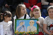 Children hold a gift showing St. Teresa of Kolkata and Pope Francis before the pope's visit to the Mother Teresa Memorial in Skopje, North Macedonia, May 7, 2019. (CNS photo/Paul Haring)