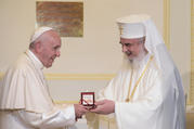 Pope Francis and Romanian Orthodox Patriarch Daniel exchange gifts at the patriarchal palace in Bucharest, Romania, May 31, 2019. The pope is making a three-day visit to Romania. (CNS photo/Vatican Media)