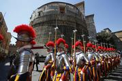 Recruits of the Vatican's Swiss Guard march in front of the tower of the Institute for Works of Religion in 2014. (CNS photo/Tony Gentile, Reuters)