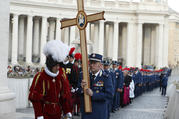 Domenico Giani, former chief of the Vatican police force, holds a cross as Vatican police officers and Swiss Guards process through St. Peter's Square in September 2016. Pope Francis appointed Gianluca Gauzzi Broccoletti, a cybersecurity expert, as the new head of the Vatican Security Services on Oct. 15. (CNS photo/Paul Haring)