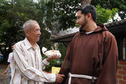 Capuchin Friar Luis Antonio Salazar greets a man in Caracas, Venezuela, who received a free meal at the Our Lady of Chiquinquira Parish on Oct. 12, 2019. Every Saturday the parish organizes free meals for hundreds of needy people. (CNS photo/Manuel Rueda)
