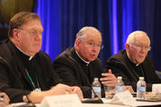 Archbishop Jose H. Gomez of Los Angeles, president-elect of the U.S. Conference of Catholic Bishops, responds to a question during a news conference at the fall general assembly of the USCCB in Baltimore Nov. 12, 2019. Also pictured are: Cardinal Joseph W. Tobin of Newark, N.J., and Archbishop Leonard P. Blair of Hartford, Conn. (CNS photo/Bob Roller)