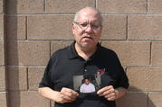 Auska Mitchell holds a photograph of his nephew, Lezmond Mitchell, on Aug. 21 in the Phoenix area. Lezmond Mitchell is scheduled to be executed this Wednesday, Aug. 26. (AP Photo/Jonathan J. Cooper)