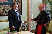 U.S. Secretary of State Mike Pompeo talks with Cardinal Pietro Parolin, Vatican secretary of state, during a meeting at the Vatican Oct. 1, 2020. (CNS photo/Vatican Media)