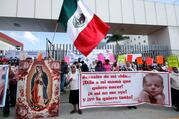 Pro-life supporters pray during a 2019 protest outside the local congress in Oaxaca, Mexico. In late July, Mexico's bishops called on Catholics to speak out ahead of a ruling from the country's Supreme Court, which could lead to a nationwide decriminalization of abortion. (CNS photo/Jorge Luis Plata, Reuters)