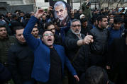 Demonstrators react during a Jan. 3, 2020, protest in front of U.N. offices in Tehran, Iran, after Iranian Maj. Gen. Qassem Soleimani was killed in a U.S. drone airstrike at Baghdad International Airport earlier that day. (CNS photo/Nazanin Tabatabaee, West Asia News Agency via Reuters)