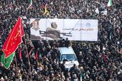 Mourners attend a funeral procession for Iranian Maj. Gen. Qasem Soleimani and Iraqi militia commander Abu Mahdi al-Muhandis in Tehran, Iran, Jan. 6, 2020. The two men were killed Jan. 3 in a U.S. drone airstrike at Baghdad International Airport. (CNS photo/Nazanin Tabatabaee/, West Asia News Agency via Reuters)