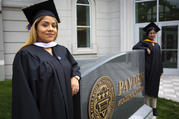"Brenda and Yarely—two ""Dreamers"" posing for a photo before their 2018 graduation from Trinity Washington University—consider themselves symbols of the Deferred Action for Childhood Arrivals program, which provides legal protections and work authorization to immigrants brought to the U.S. as children by their parents without legal documents. On June 18, 2020, the U.S. Supreme Court handed down a 5-4 ruling rejecting President Donald Trump's executive order to cancel DACA. (CNS photo/Chaz Muth)"