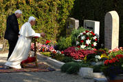 Msgr. Georg Ratzinger and his brother, now-retired Pope Benedict XVI, are seen in 2006 praying at their parents' grave in Pentling, Germany. Msgr. Ratzinger died July 1 at the age of 96. (CNS photo/Wolfgang Radtke, KNA)