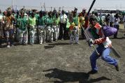 Mine workers sing during the commemoration ceremonies in Marikana, South Africa, on Aug. 16, 2017. Protestors complain that no one has been punished and conditions have not improved since Aug. 16, 2012, when police opened fire on workers demanding wage increases and better living conditions. (AP Photo/Themba Hadebe)