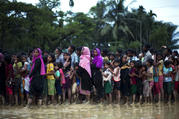 Rohingya Muslims, who crossed over recently from Myanmar into Bangladesh, stand in a queue to receive food being distributed near Balukhali refugee camp in Cox's Bazar, Bangladesh, on Tuesday, Sept. 19, 2017. More than 500,000 Rohingya Muslims have fled to neighboring Bangladesh in the past year, most of them in the last three weeks, after security forces and allied mobs retaliated to a series of attacks by Muslim militants last month by burning down thousands of Rohingya homes in the predominantly Buddhist
