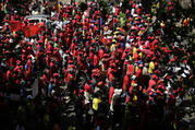 Workers march in Johannesburg, South Africa, on Sept. South Africa's biggest union group held marches nationwide to protest what it alleges is chronic corruption fueled by President Jacob Zuma and a prominent family of businessmen, reflecting public anger over a scandal that has ensnared several international companies. (AP Photo/Themba Hadebe)