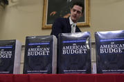 James Knable helps to unpack copies of the President's FY19 Budget after it arrived at the House Budget Committee office on Capitol Hill in Washington, Monday, Feb. 12, 2018. (AP Photo/Susan Walsh)