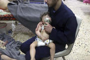 A medical worker gives a child oxygen following an alleged poison gas attack in the opposition-held town of Douma, near Damascus, Syria, on April 8. (Syrian Civil Defense White Helmets via AP)