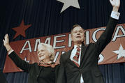 In this Nov. 8, 1988 file photo, President-elect George H.W. Bush and his wife Barbara wave to supporters in Houston, Texas after winning the presidential election. (AP Photo/Scott Applewhite, File)​​​​​​​