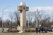 Visitors walk around the 40-foot Maryland Peace Cross dedicated to World War I soldiers on Wednesday, Feb. 13, 2019 in Bladensburg, Md. (AP Photo/Kevin Wolf)