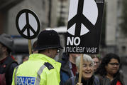 Anti war demonstrators hold banners as they protest outside Westminster Abbey, as a service to recognize 50 years of continuous deterrent at sea takes place in London on May 3. (AP Photo/Kirsty Wigglesworth)
