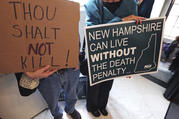 Protestors gather outside the Senate Chamber prior to a vote on the death penalty at the State House in Concord, N.H., Thursday, May 30, 2019. New Hampshire, which hasn't executed anyone in 80 years and has only one inmate on death row, on Thursday became the latest state to abolish the death penalty when the state Senate voted to override the governor's veto. (AP Photo/Charles Krupa)